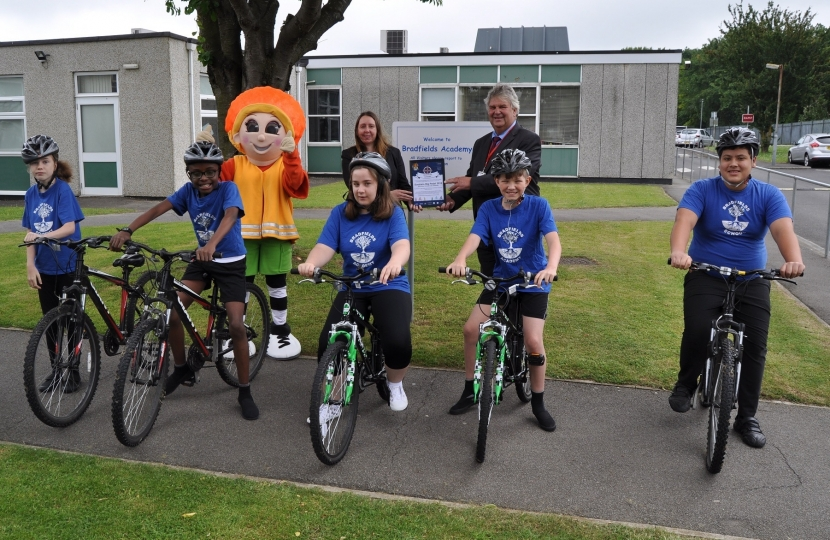 Councillor Filmer with the children of Bradfields academy and their bikes