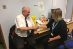 Councillor David Brake receiving his flu vaccination