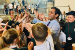 Rehman Chishti high-fives children visiting parliament