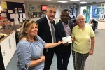 Councillors Mackness and Tejan presenting a cheque for £1000 to the RVS
